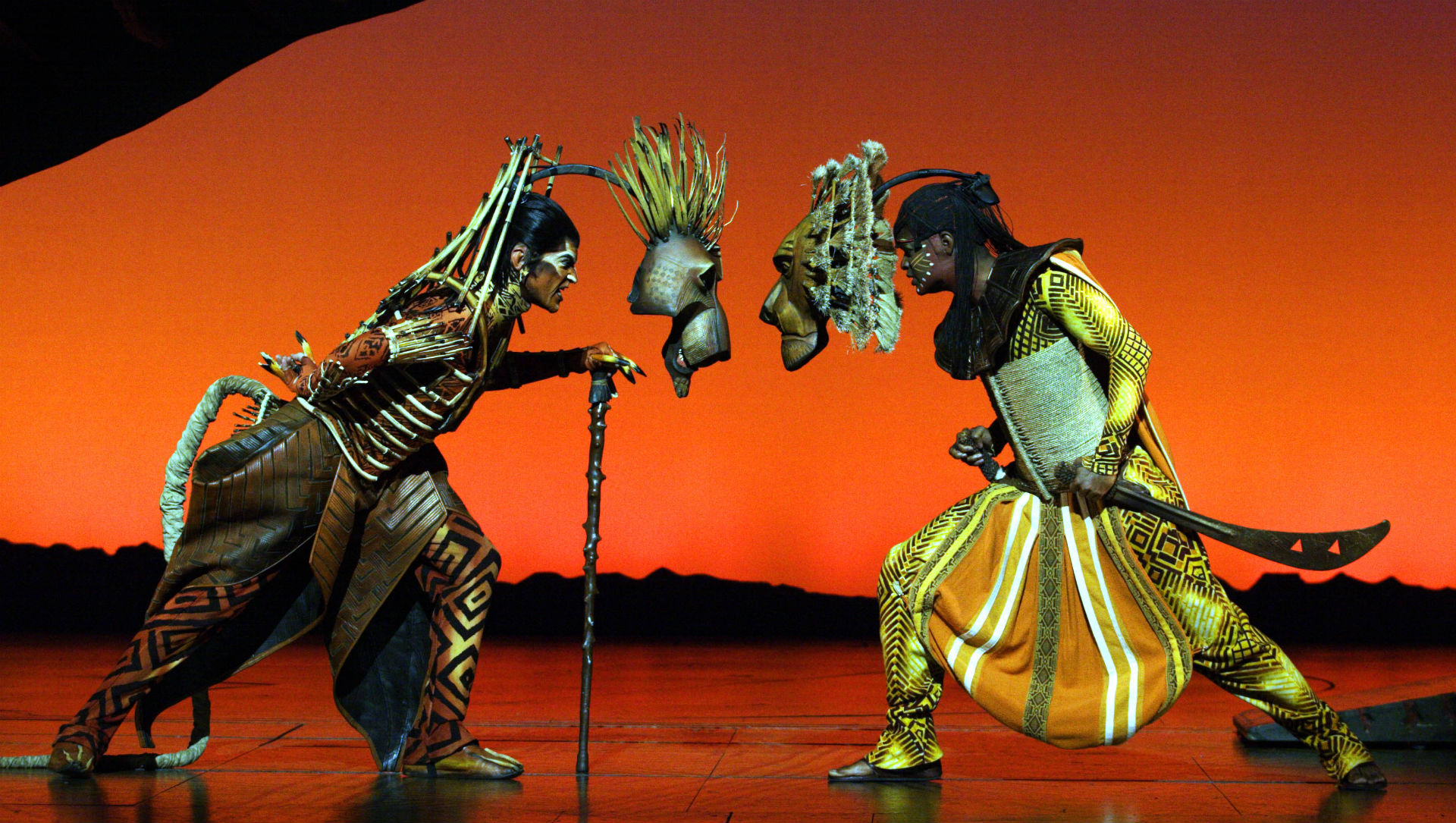 Mufasa and Scar face off on the Lyceum Theatre stage in the Lion King live production